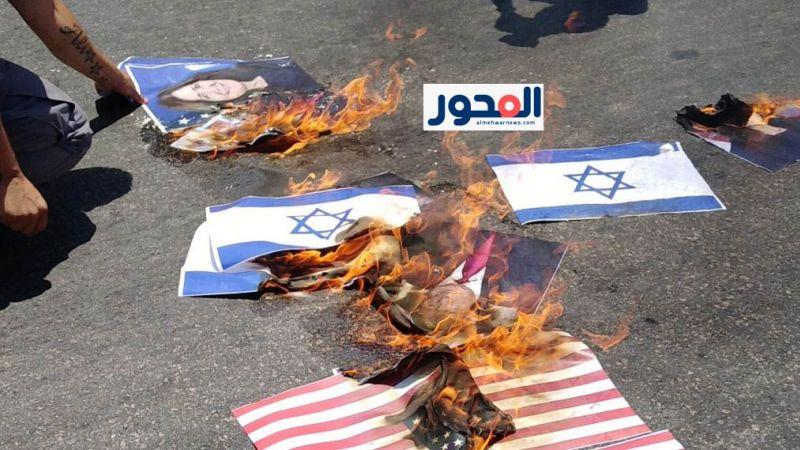 إحراق العلمين الأميركي والصهيوني في اعتصام حاشد على طريق المطار